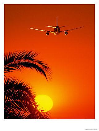Airplane-flying-over-sunrise--C11986067